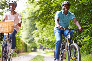 smiling woman and man riding bikes